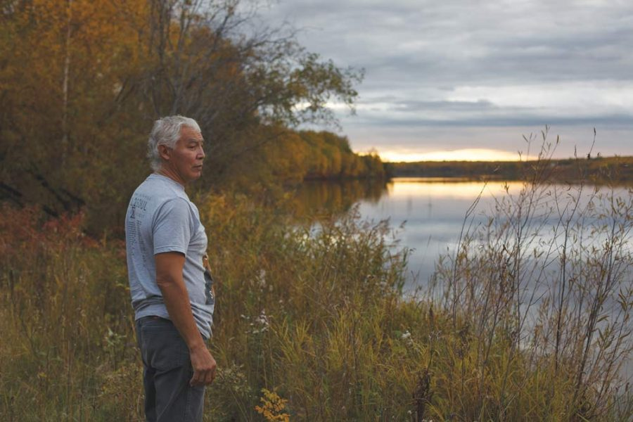Harold Blyan, vice-chairman of Alberta's Buffalo Lake Métis Settlement, looks out over the water near his home.