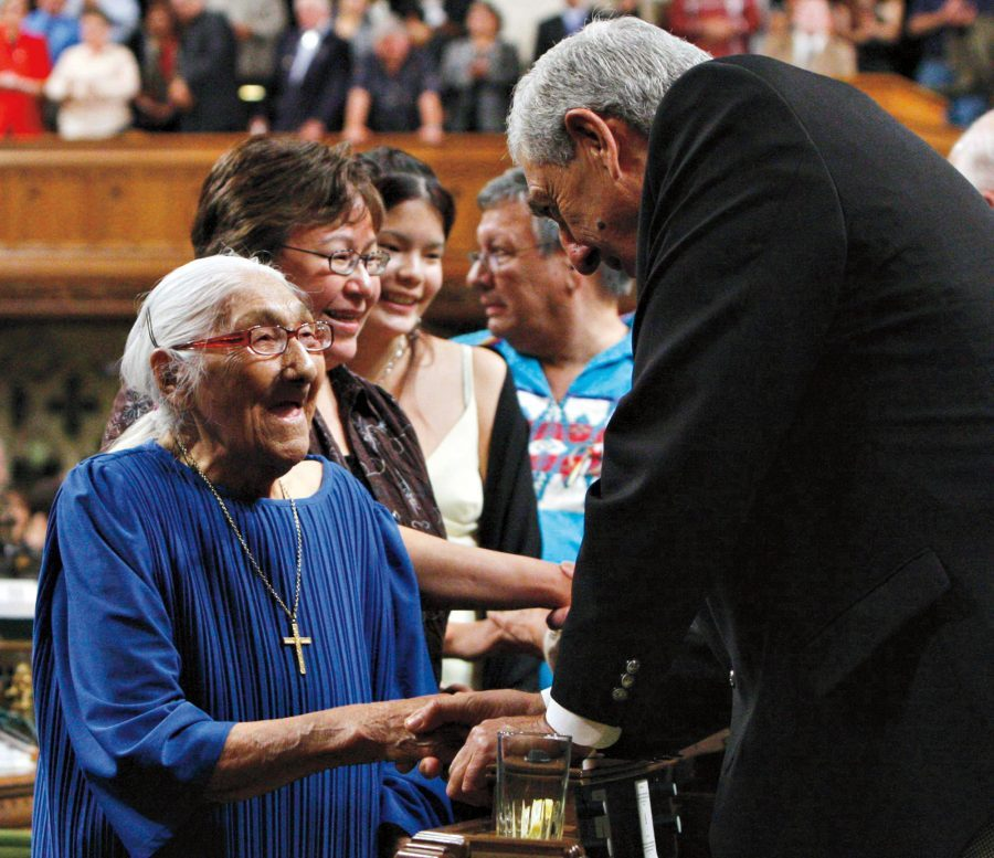 The then-oldest surviving residential school victim, Wabano Marguerite, is greeted in the House of Commons on June 11, 2008, during the federal government's apology for residential schools.