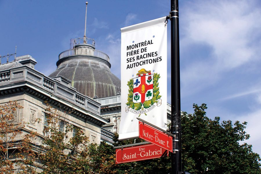 White banner featuring Montreal's new Coat of Arms on Notre-Dame E. Rec.