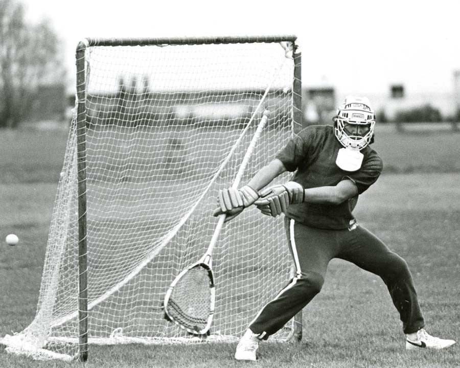 A lacrosse player defends his net