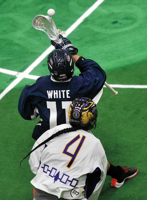 Two lacrosse players battle for the ball at the Lacrosse Championship