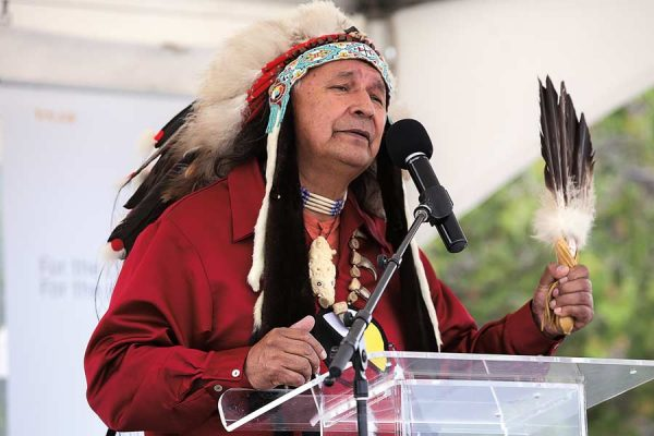 A First Nations elder speaks into a microphone in Ottawa