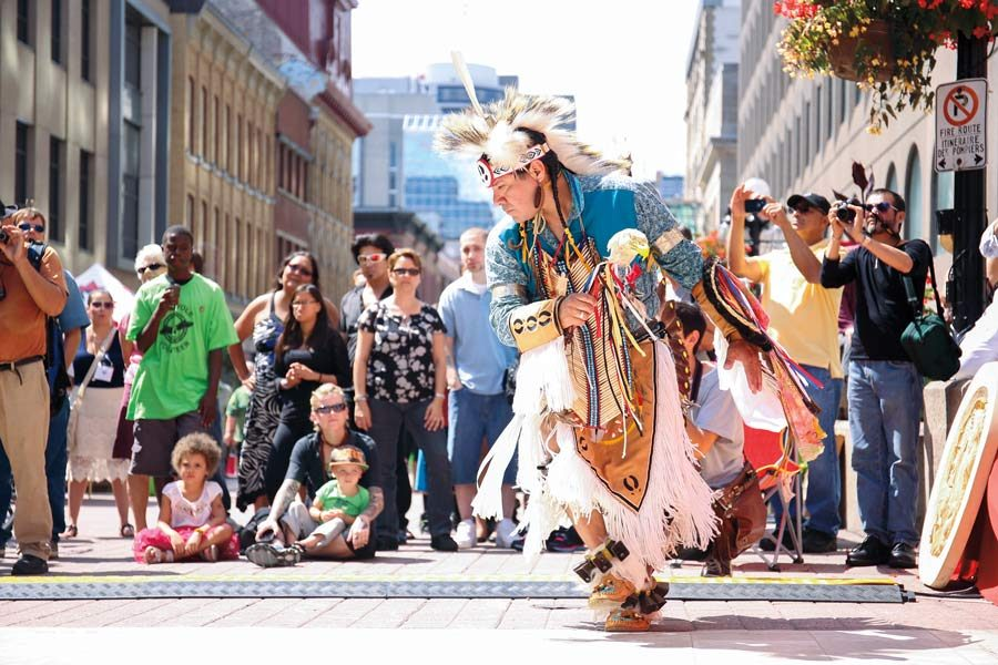 A man dressed in traditional clothing dances in Ottawa
